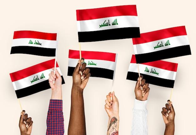 Mãos, waving, bandeiras, de, iraque