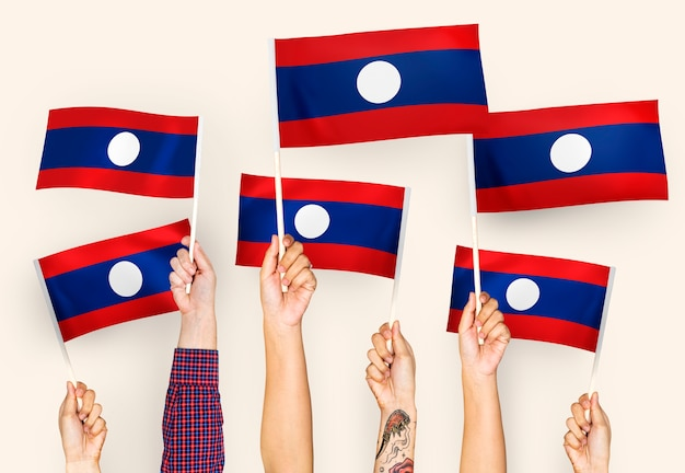 Mãos, waving, bandeiras, de, lao, pdr