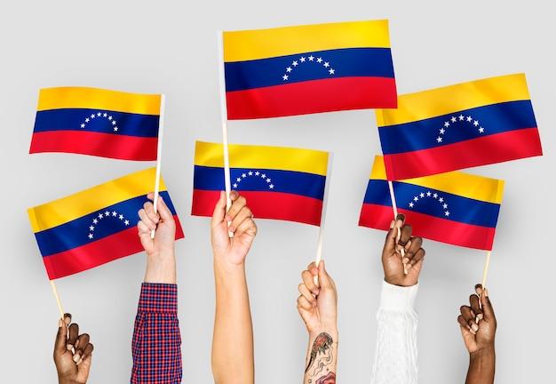 Mãos, waving, bandeiras, de, venezuela