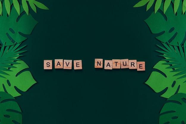 Maquete criativa feita de folhas tropicais com a inscrição