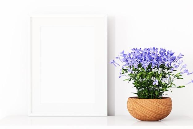 Maquete da moldura e flores azuis