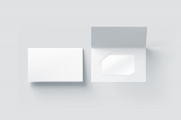 Maquete de cartão de plástico branco em branco dentro do suporte de livreto de papel