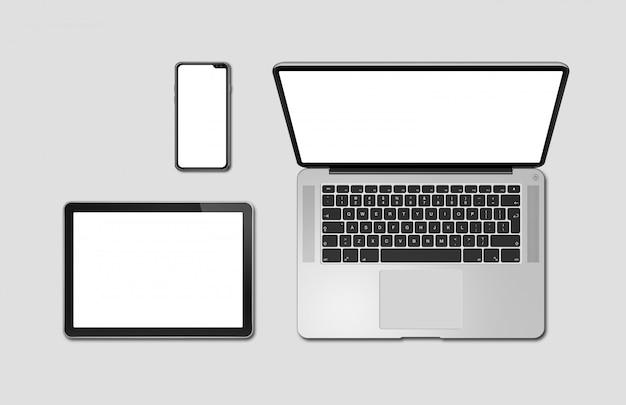 Maquete de laptop, tablet e aparelho telefônico isolada em cinza. renderização em 3d