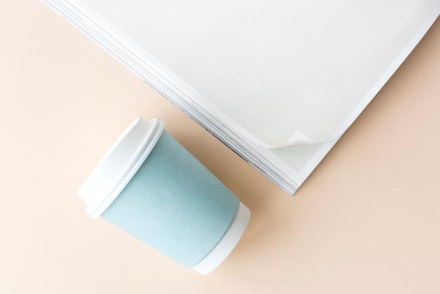 Maquete de livro e xícara de café