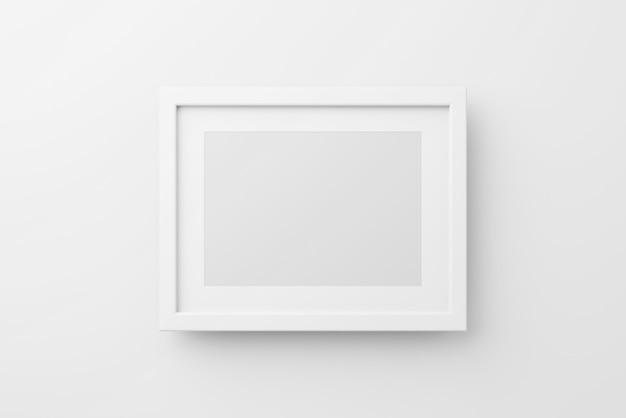 Maquete de moldura de foto de parede retangular em fundo branco