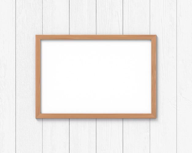 Maquete de molduras de madeira horizontal pendurado na parede. base vazia para imagem ou texto. renderização em 3d.