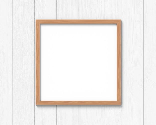 Maquete de molduras quadradas de madeira pendurado na parede