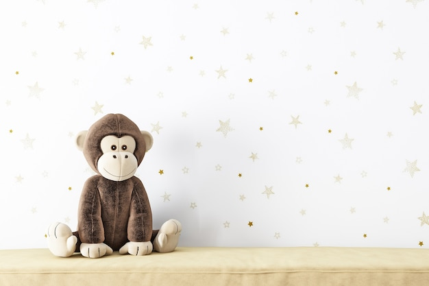 Maquete de parede em branco e brinquedo de pelúcia um macaco