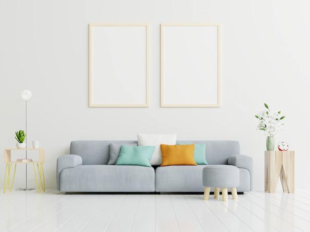 Maquete de pôster com pé de quadro vertical no chão no interior da sala de estar com sofá cinza.