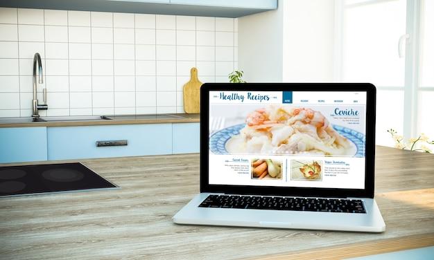 Maquete de receitas saudáveis do laptop da tela do blog na ilha de culinária na cozinha
