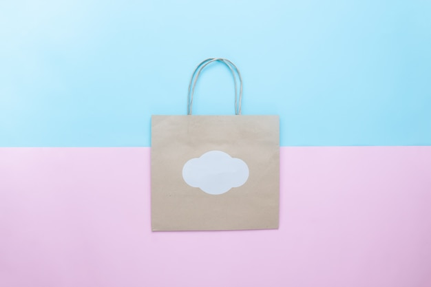 Maquete de saco de compras de papel ofício para a marca, saco de compras em fundo de cor pastel