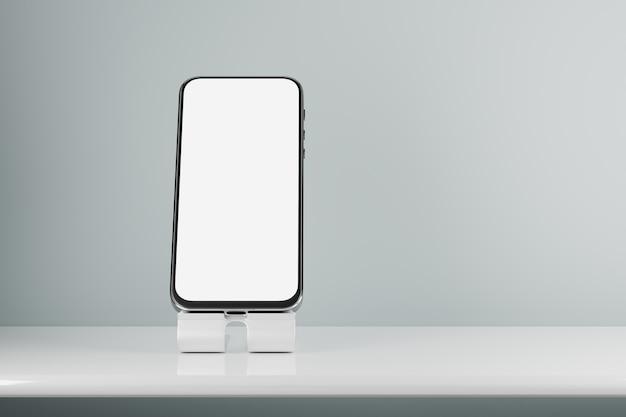 Maquete de smartphone com tela branca. uma maquete de um smartphone em um suporte sobre a mesa. renderização 3d.