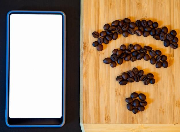Maquete de telefone móvel com símbolo de wifi de grãos de café