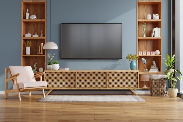 Maquete de tv no gabinete em uma sala vazia moderna com a renderização de parede 3d em azul escuro.