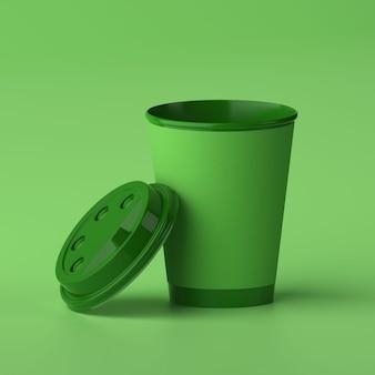 Maquete do projeto 3d do copo de café de papel copo verde sobre fundo verde