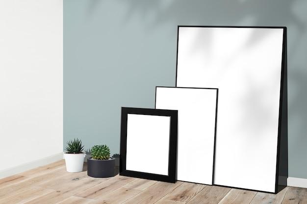 Maquetes de quadro contra uma parede
