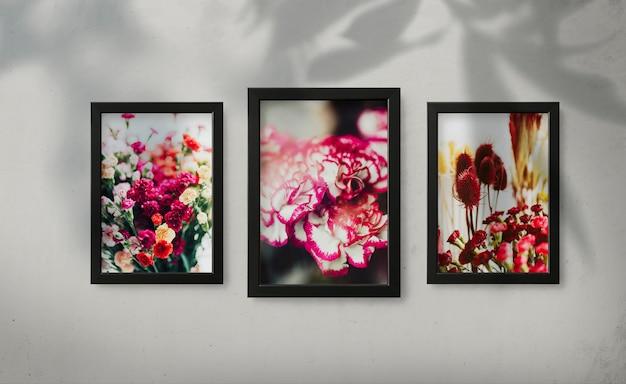 Maquetes de quadro moderno em uma parede cinza