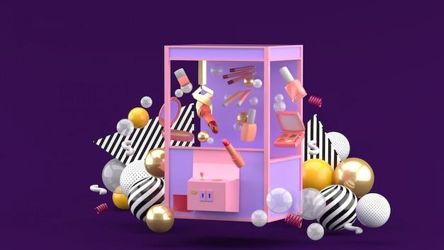 Máquina de apanhador de cosméticos em meio a bolas coloridas em um espaço roxo