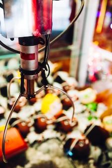 Máquina de arcade de gancho de close-up