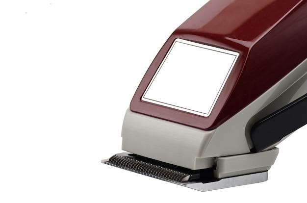 Máquina de cortar cabelo na cabeça em um fundo branco isolado