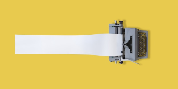 Máquina de escrever antiga com papel muito comprido e fundo amarelo com espaço para texto