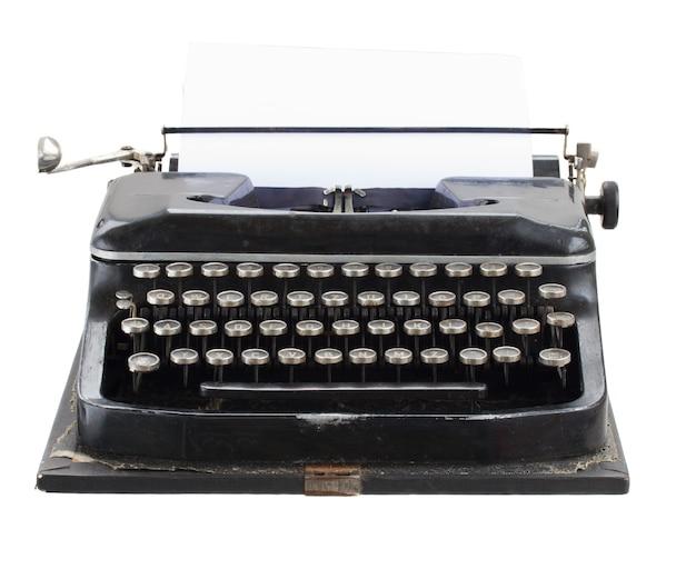 Máquina de escrever vintage preta com página em branco vazia, isolada no fundo branco