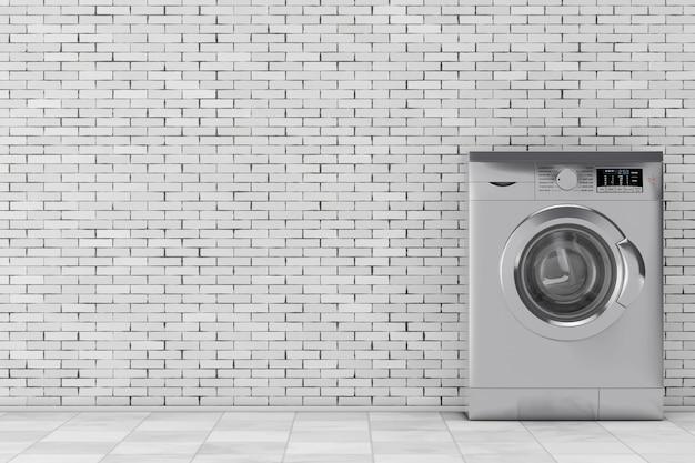 Máquina de lavar roupa metálica moderna na frente da parede de tijolos. renderização 3d.