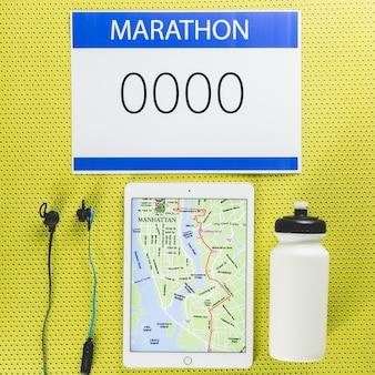 Marathon e tableta com mapa