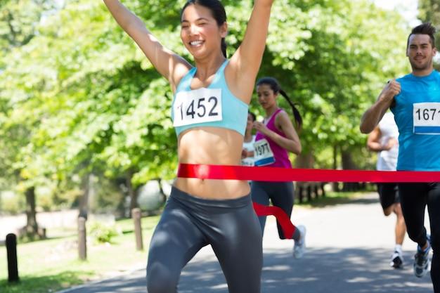 Marathon runner crossing meta line