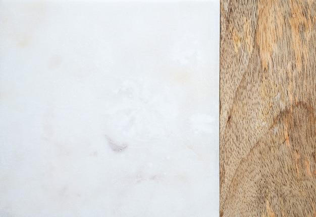 Mármore branco, fundo de pedra com bambu. fundo de textura natural. recurso gráfico. vista do topo. postura plana Foto Premium