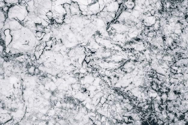 Mármore ou granito, laje de pedra. preto e branco. pode ser usado como pano de fundo de textura