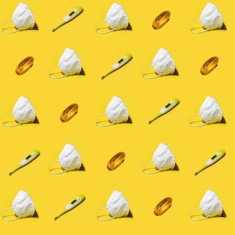 Máscara kn95 de respirador de medicamento branco, termômetro eletrônico médico e padrão sem emenda de vitamina cápsula de comprimido em amarelo