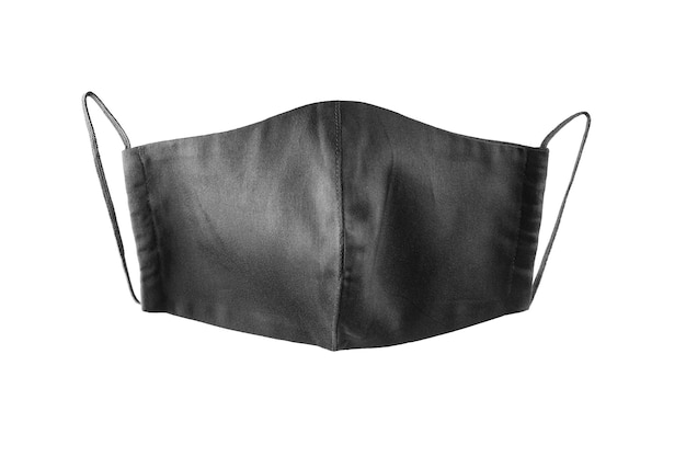 Máscara protetora de rosto negro isolada. máscara de pano reutilizável isolada. isolar