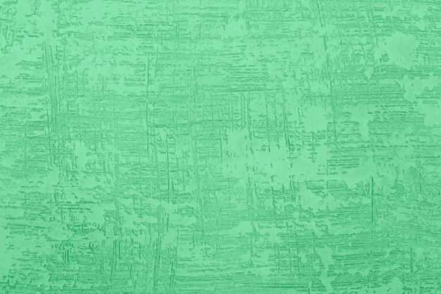 Massa de vidraceiro textured na parede. fundo de parede áspera grunge.