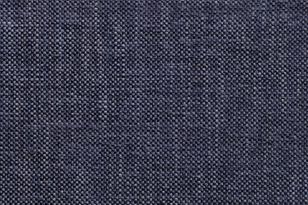 Matéria têxtil da sarja de nimes com teste padrão quadriculado, close up. estrutura da macro de tecido.