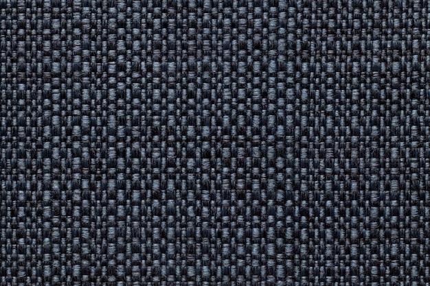 Matéria têxtil dos azuis marinhos com teste padrão quadriculado, close up. estrutura da macro de tecido.