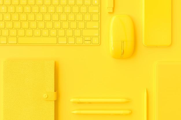 Material informático amarelo na mesa de trabalho.