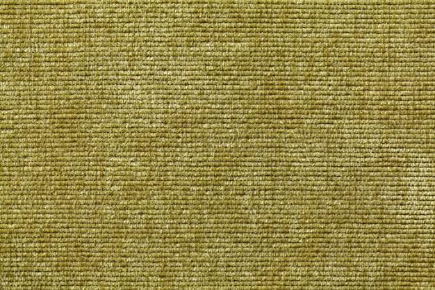 Material têxtil macio verde oliva., tecido com textura natural.