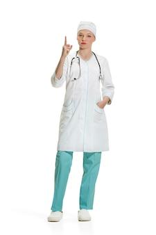 Médica, apontando para cima com o dedo. conceito de saúde