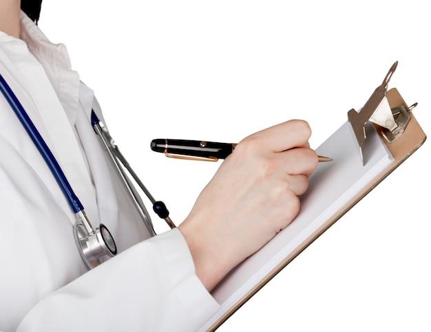Médica com estetoscópio no fundo