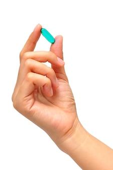 Medicina em uma mão no fundo branco