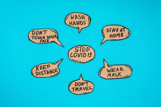 Medidas para impedir a propagação do coronavírus, 19 secretas, escritas em bolhas dos desenhos animados sobre o fundo azul. lave as mãos, fique em casa, use máscara, não viaje, mantenha distância, não toque em seu rosto.