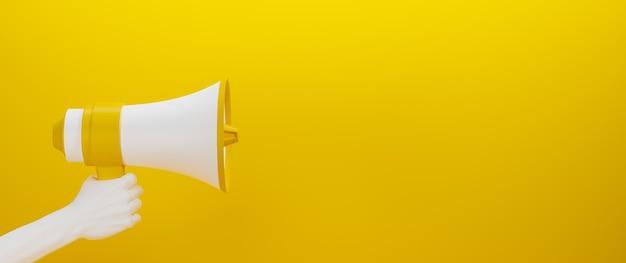 Megafone amarelo e branco segurado por uma mão branca na superfície amarela