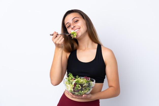 Menina adolescente com salada