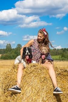 Menina, com, dois, cachorros