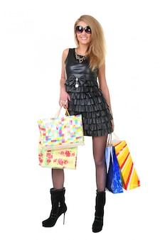 Menina com sacolas de compras