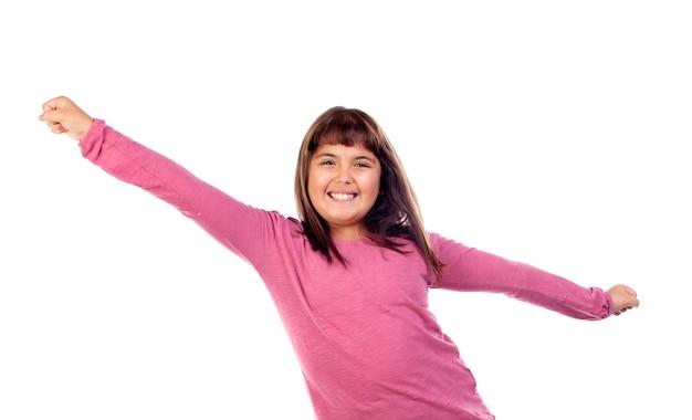 Menina criança feliz, com, cor-de-rosa, t-shirt, esticar, dela, braços