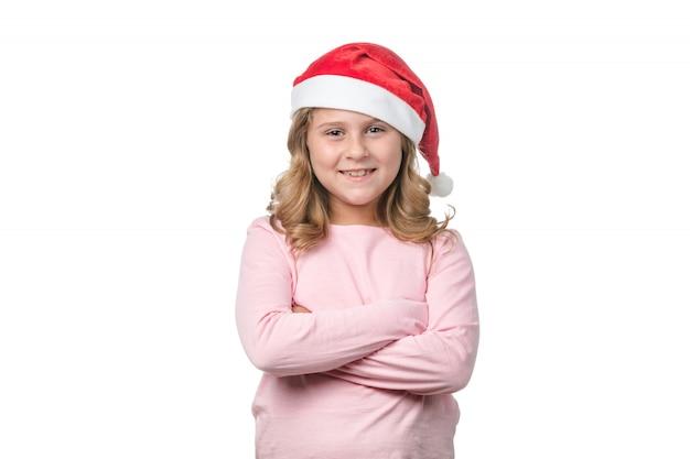 Menina de chapéu de papai noel vermelho
