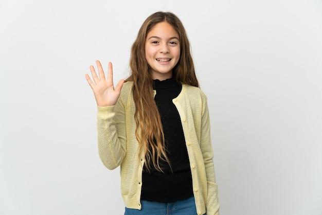 Menina sobre fundo branco isolado saudando com a mão com uma expressão feliz
