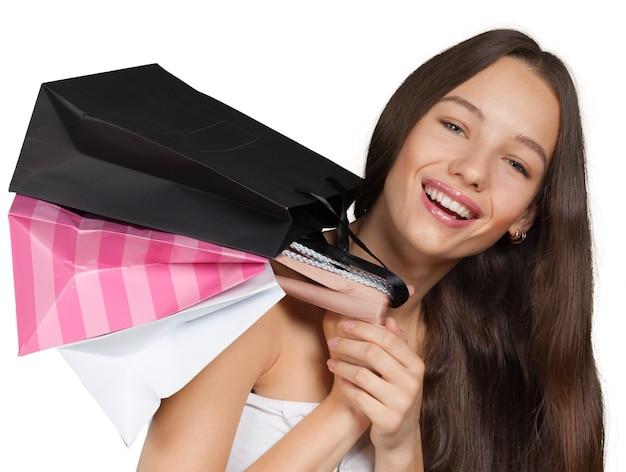 Menina sorridente, com, bolsas para compras